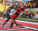 Sep 12, 2015; Jonesboro, AR, USA; Arkansas State Red Wolves wide receiver Tres Houston (15) catches a pass for a touchdown in the first half as Missouri Tigers defensive back Kenya Dennis (7) defends at ASU Stadium. Mandatory Credit: Nelson Chenault-USA TODAY Sports